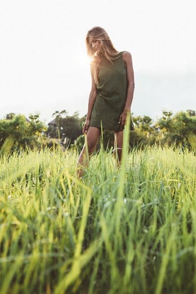 Beautiful young Ukrainian lady walking through the meadow alone